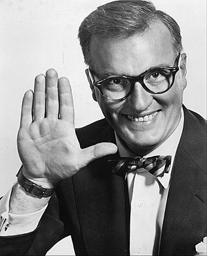 "Dave Garroway - Garroway's signature upraised hand while saying ""Peace"""