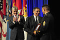 Defense.gov News Photo 110713-F-RG147-329 - Medal of Honor recipient Sgt. 1st Class Leroy A. Petry receives the Medal of Honor flag from Secretary of Defense Leon E. Panetta as Secretary of.jpg