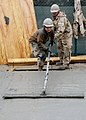 Defense.gov News Photo 120217-N-SD610-012 - Petty Officer Selina Rodriguez assigned to Naval Mobile Construction Battalion 7 uses a bull float to finish concrete at Kandahar Airfield on.jpg