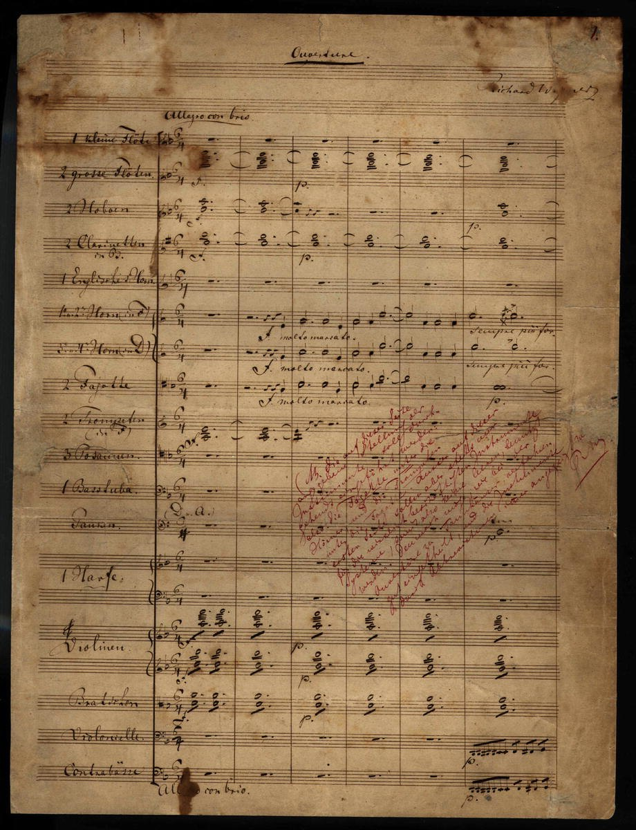 """Six bars of music are written across 19 pre-printed staves. The page is headed """"Overture"""". Below the heading to the right is Wagner's name. The tempo indication is allegro con brio. Several lines are written diagonally in lighter handwriting."""