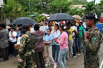 Dominicans and Haitians lined up to attend medical providers from the U.S. Army Reserve Dominicans and Haitians Braving the Weather.jpg