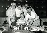 1957 B&W photograph of Donn Reynolds (far left) in recording studio with George Morgan, Wesley Rose, Boudleaux Bryant, and Eddy Arnold (Nashville, Tennessee).