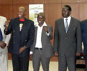 Douglas Wakiihuri - Wakiihuri (on the left) with Samuel Wanjiru (center) and Raila Odinga at the Japanese Embassy in Kenya in March 2011