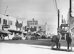 Fairbanks, Alaska - Photo taken by Elisabeth Meyer in 1955, looking easterly from Second Avenue and Cushman Street. The now-abandoned Polaris Building, the tallest building in Fairbanks since its completion in 1952, is in the background.