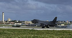 A B-1B Lancer assigned to the 9th Expeditionary Bomb Squadron lands at Andersen AFB in 2007. The rotation of aircraft in support is designed to demonstrate the US's commitment to the Indo-Asia-Pacific region