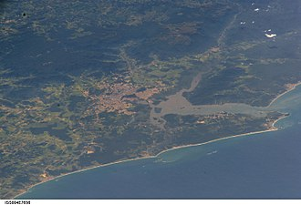 Araquari - ISS image from 2005 showing the city of Joinville (center) with the Baía da Babitonga, Araquari (center below), to the right São Francisco do Sul with the coast of the South Atlantic.