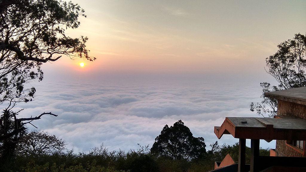 Early sunrise above clouds Nandi hills Bangalore