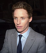 A photo of Eddie Redmayne attending the Toronto International Film Festival in 2014.