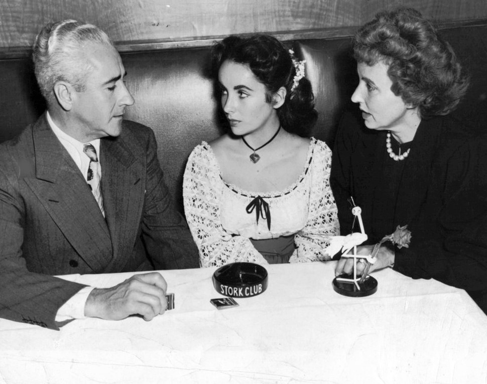 Elizabeth Taylor with parents at Stork Club 1947