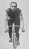 Male cyclist on a bicycle headed straight toward the camera