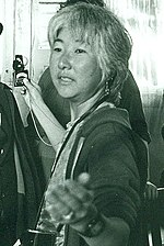 Emiko Omori takes a light reading off Victor Wong's face - cropped.jpg