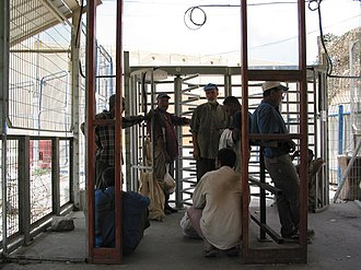 Blockade of the Gaza Strip - Palestinian workers wait at the Erez Crossing to enter the Gaza Strip, July 2005.