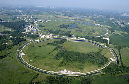 Aerial view of Fermilab, a science research laboratory co-managed by the University of Chicago. Fermilab.jpg