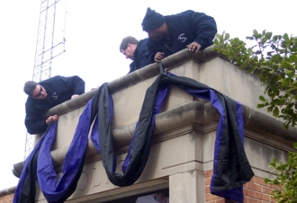 Kirkwood City Council shooting - Firefighters laying bunting above the Kirkwood Police Department entrance as a memorial on February 8