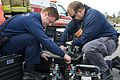 Firefighters prep for simulated fuel spill 130320-N-LN619-167.jpg