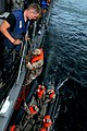 Flickr - Official U.S. Navy Imagery - A Sailor mans a pilot's ladder as members of the Mauritania's navy boarding team climb aboard USS Simpson..jpg