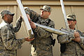 From left- U.S. Air Force Capt. Jose Milan together with Master Sgts. Todd Ludwig and Matthew Trower attached the solar panel of a solar powered light to a pole at Bagram Airfield, Afghanistan, Feb. 23, 2010 100223-F-PI632-113.jpg