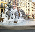 "Frozen ""Fontaine Bartholdi"" during winter in Lyon, France.jpg"