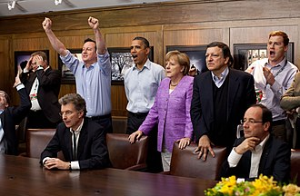 José Manuel Barroso - British Prime Minister David Cameron and German Chancellor Angela Merkel watching the 2012 UEFA Champions League Final with Barroso, US President Barack Obama, French President François Hollande and others during the G8 summit.