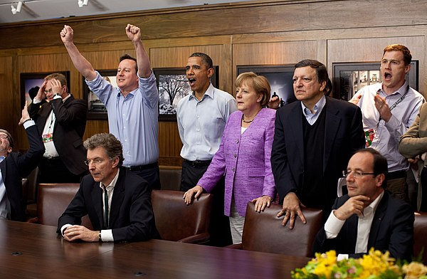 Cameron, Barack Obama, Angela Merkel, Francois Hollande, and others watch the penalty shootout of the 2012 UEFA Champions League Final. Cameron is celebrating Chelsea's victory over Bayern Munich. G8 leaders watching football.jpg