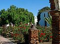 Garden and Pepper Tree, Mission San Luis Rey, CA 9-16 (30824095672).jpg
