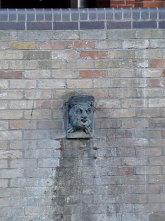 Magdalene College, Cambridge - The modern gargoyle of Benedict Spinola in the Quayside site