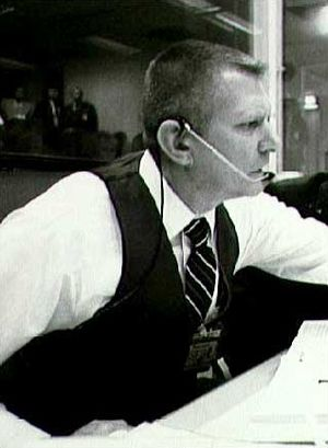 Gene Kranz - Gene Kranz wearing a dark vest (NASA picture)