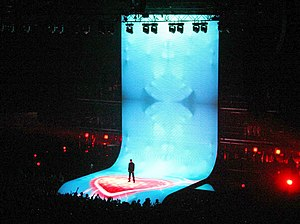 Fastlove - Michael performing the song at 25 Live in 2006, with the backdrop contains scenes from the music video.