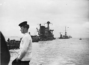 HMS Durban (D99) - HMS Durban and HNLMS ''Sumatra'' half-sunk amid a line of block ships, 9 June 1944