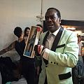 Harry Waters, Jr. with a Marvin Berry doll 2.jpg