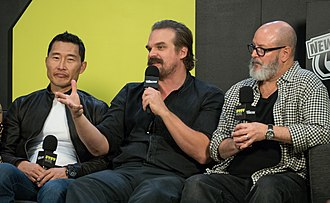 Hellboy (2019 film) - Daniel Dae Kim, David Harbour, and Mike Mignola during an interview at New York Comic Con in October 2018