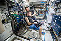 ISS-45 Kjell Lindgren gives Oleg Kononenko a haircut in the Harmony module.jpg