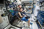 ISS-45 Kjell Lindgren gives Oleg Kononenko a haircut in the Harmony module.jpg