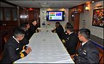 Indian Navy officers interact the with the Commanding Officer of HMAS Arunta on board INS Satpura.jpg