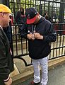 Indians skipper Terry Francona signs for fans before -WorldSeries Game 1. (30477227311).jpg
