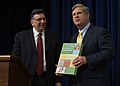 Innovation Center for U.S. Dairy Chief Executive Officer (CEO) Tom Gallagher presents Agriculture Secretary Tom Vilsack with a memento before the signing a Memorandum of Understanding (MOU).jpg