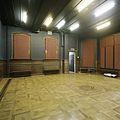 Interieur, overzicht van de linker achterkamer met eikenhouten lambrisering en parketvloer - Tilburg - 20388635 - RCE.jpg