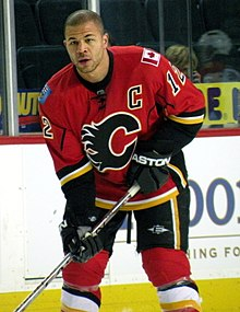 Iginla stands near the boards, without his helmet, during a pre-game warm-up.