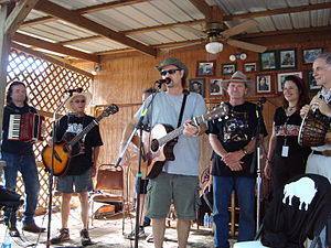 Red Dirt (music) - Jimmy LaFave performing at the Woody Guthrie Folk Festival along with (L-R) Radoslav Lorković, Joel Rafael, Butch Hancock, Audrey Auld Mezera and David Amram. July 12, 2008.