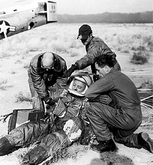 Project Excelsior - A ground crew assists Joe Kittinger in removing his fight gear after the successful flight of Excelsior III. Despite the appearances, Kittinger was fine.