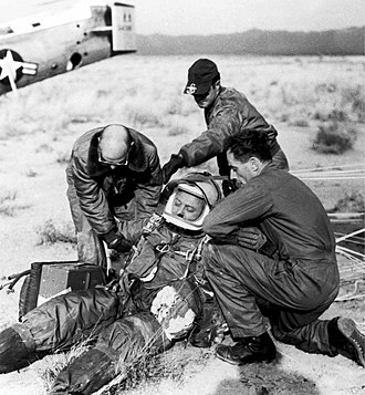 Project Excelsior - A ground crew assists Joe Kittinger in removing his flight gear after the successful flight of Excelsior III. Despite the appearances, Kittinger was fine.
