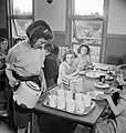 June Beale pours tea for other evacuee children in the dining hall at Marchant's Hill school, Hindhead, Surrey, 1944. D21623.jpg