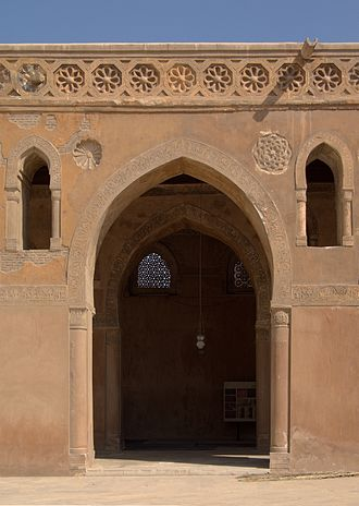 Islamic geometric patterns - Mosque of Ibn Tulun: window with girih-style 10-point stars (at rear), with floral roundels in hexagons forming a frieze at front
