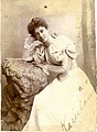 Kaiulani in Jersey, seated with her head resting on her right hand on a rock, facing left, photograph by Tynan Bros, signed.jpg