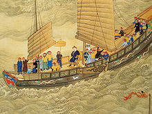 The Kangxi Emperor (r. 1654–1722) on a tour, seated prominently on the deck of a junk ship.