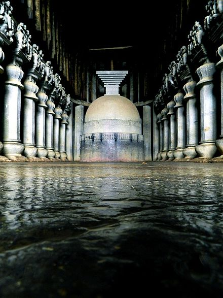 Cave complex associated with the Mahasamghika sect. Karla Caves, Maharastra, India Karla chaitya stupa.JPG