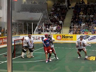 Peterborough Lakers (MSL) - Players struggle for position during a Lakers vs Excelsiors game.