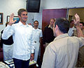 Larsen Jensen, left, a two-time Olympic medalist, takes the oath of office at the headquarters of Navy Recruiting District Los Angeles, Calif., April 15, 2009, before departing for Officer Candidate School 090415-N-FH966-006.jpg