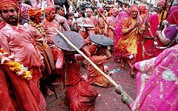 holi in the braj region of north women have the option to playfully hit men who save themselves shields for the day men are culturally expected to