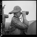 Lawrence Britton (SN2), on duty at port lookout aboard USS Nassau (CVE-16). - NARA - 520755.tif